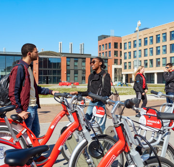 Students using the Santander bikes on Bay Campus